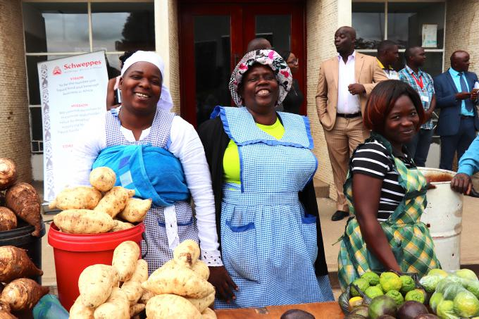 Informal traders selling vegetables in Harare