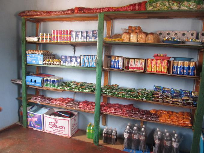A fully stocked tuckshop being managed by child protection committee members