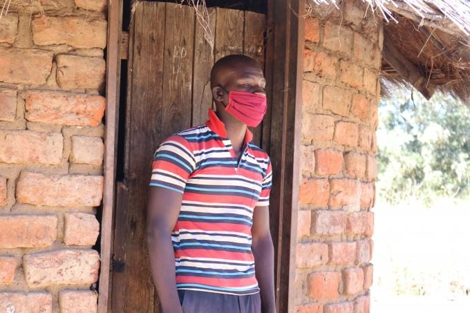 Muchengeti wearing a face mask he was given by Save the Children