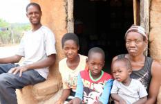 Deputy sits with husband, Mlungisi and their three children