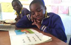 A girl reading in class