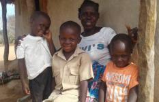 Norah and her child (in school uniform) and her two grandchildren
